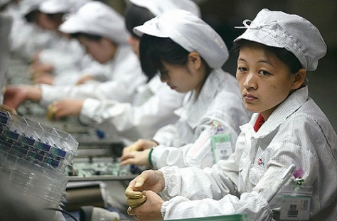 Workers assemble iPhones at a Foxconn facility in Shenzhen, China.